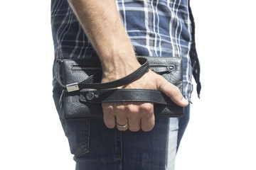 A guy in jeans and a shirt with a purse on his hand,  Isolate