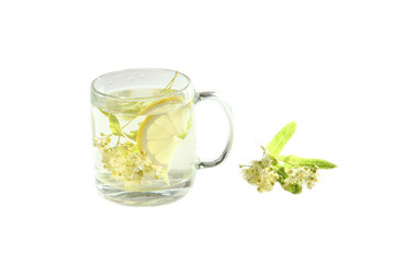 Lime tea with lemon in a glass cup