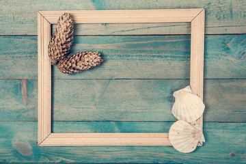 Photo frame with two pine cones and sea shells