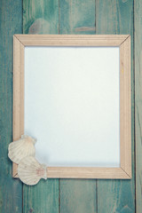 Blank photo frame with sea shells