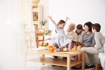 Grandchildren telling stories to grandparents