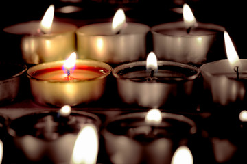Selective focus and close Up Group of burning candles in thai style  and concept of peace, meditation and relaxation