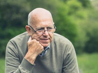Senior man resting in nature