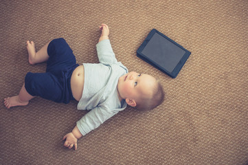 Baby on the floor with tablet computer