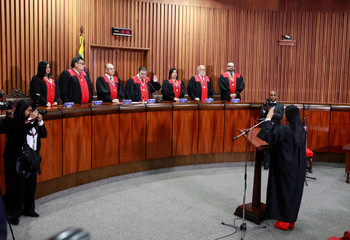 Members of the Supreme Court of Justice (TSJ) swear Katherine Haringhton in as Vice-Prosecutor in Caracas