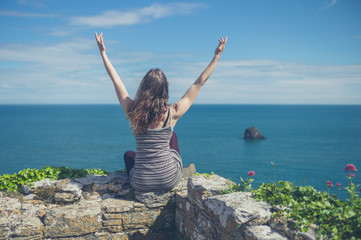Woman expressing freedom and joy by the sea