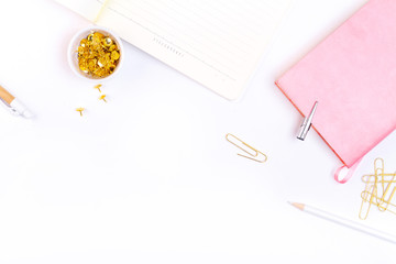 Workplace mockup with pink leather notebook and golden accessories top view. Flat lay with copy space.  Feminine working style concept.