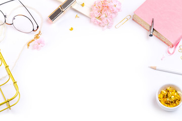 Workplace mockup with pink leather notebook, glasses and golden accessories top view. Flat lay with copy space.  Feminine working style concept.