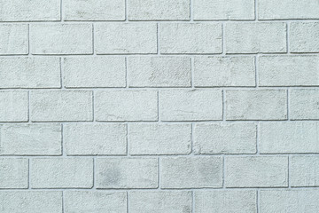 Photo texture of the plastered textured wall in the form of brick blocks of white color. Concrete block wall