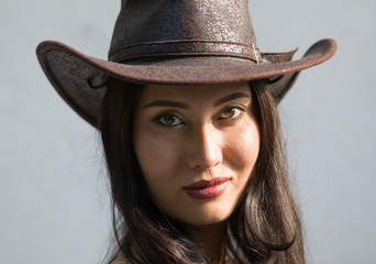 Portrait of cowboy girl, brunette