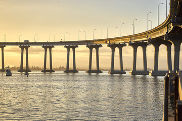Coronado bridge over sun filled bay; San Diego California