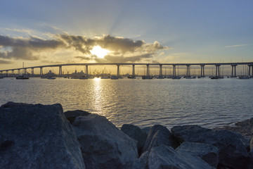 Brilliant sun coming up over the Coronado Bridge, San Diego California