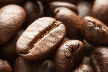 Close up roasted coffee beans.When roasted green coffee beans will swell out to almost double the size of the original.