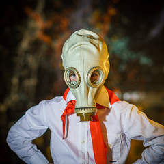 Young soviet pioneer dressed in red tie and gas mask