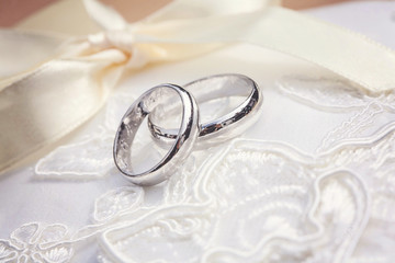 Wedding rings on beautiful background
