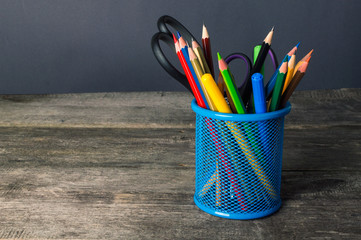 Pencil-box and school equipment on table. Back to school