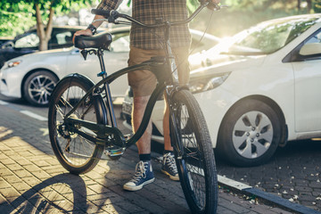 Unrecognizable Adult Man Standing With Bicycle Near Summer Cars Daily Routine Lifestyle