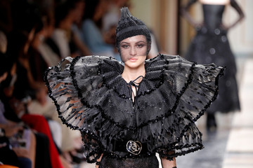 A model presents a creation by Italian designer Giorgio Armani as part of his Haute Couture Fall/Winter 2017/2018 collection show in Paris