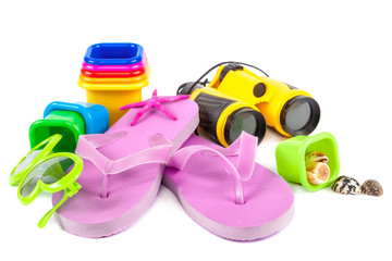 Flip-flops, molds for playing in the sand, sea shells, sun glasses, binoculars
