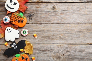 Fresh halloween gingerbread cookies on grey wooden table