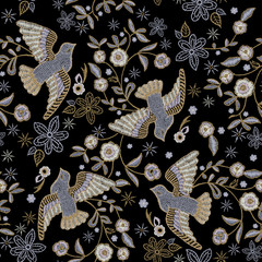 Embroidery ethnic seamless pattern with pigeons and flowers.