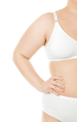 Overweight young woman in underwear on white background. Diet concept