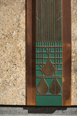 Art Deco panel in bronze and green on building exterior
