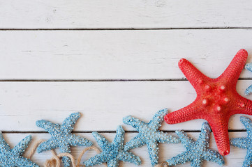 Lots of starfish sitting on a sand background, vacation background
