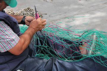 fishing nets being mended by fishermen stock, photo, photograph, image, picture,