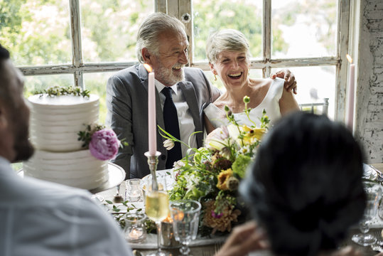 Senior Caucasian Couple Sitting Together Cheerful