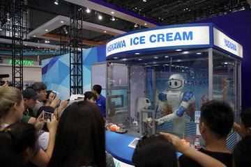 A robot by Yaskawa makes ice cream at 2017 China International Robot Show in Shanghai