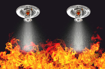 Image of Fire Sprinklers Spraying with fire background. Fire sprinklers are part of an overall safety protocol for fire and life safety.