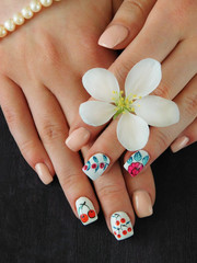 Colourful summer manicure with berries for a young woman