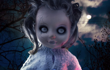 Scary doll photo. Scary ghost plastic doll with black tears on mystic night nature background photo.