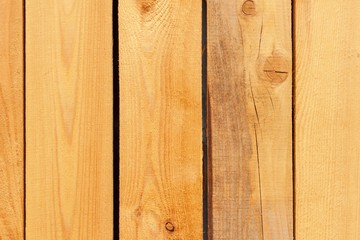 Larch boards, wall panels of the ecological house. Structure of larch wood. Place for text.