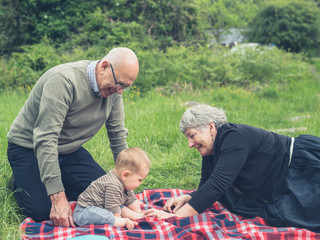 Grandparents playing with grandchild in nature