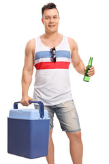 Tourist holding a cooling box and a bottle of beer