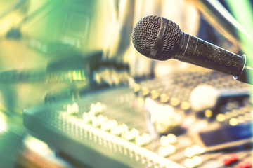 The microphone on the audio mixer. In the recording studio.