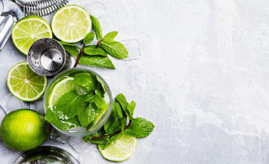 Mojito cocktail with lime, mint and ice, top view