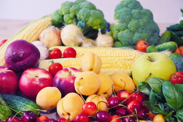 Vegetable abstract composition. Fresh vegetables: broccoli, carrot, corn, cucumber, garlic, onion, potatoes, salad, tomato, basil. Fresh Organic Vegetables. Summer Fruits: cherry, peaches, apricots.