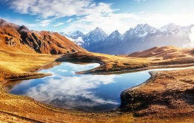 Location place lake Koruldi at the foot of Mt. Ushba. Georgia, Europe. High Caucasus ridge.