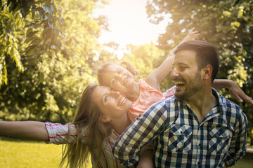 Happy family enjoying together in summer day. Family in nature.