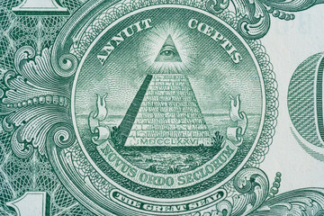 The pyramid and eye on the back of a one dollar bill macro - Close up great seal