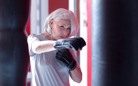 Close up of boxing elderly lady