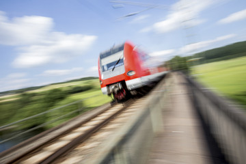 speed blurred passenger train outdoors