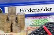 Fördergelder / Ordner mit Geld