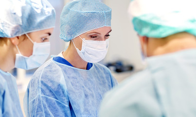 group of surgeons in operating room at hospital