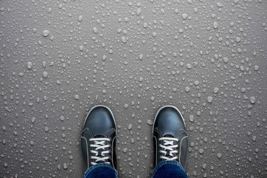 Black shoes standing on wet floor