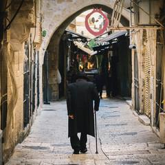 Orthodox Jewish man walks in Jerusalem's Jewish quarter