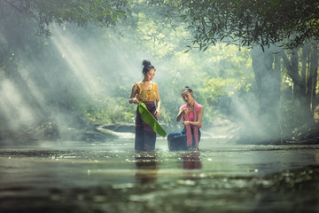 Two Lao girls are enjoying swimming in Asian rivers.